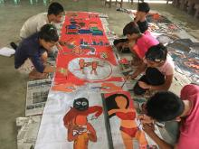 Children paint mural during Barog 2018